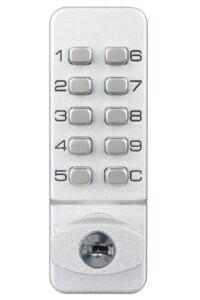 Push button cam lock